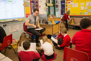 teaching school classroom with NQT and young students