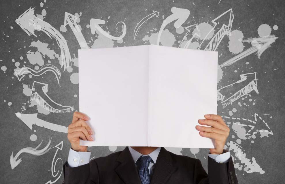 businessman with blank book and arrows choice as concept (1).jpg